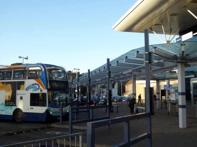 Hastings Station Interchange. Letters indicate bus stands. Timetables are displayed on poles. The shrinking but still substantial student population at the FE college can't be impressed. We should get it right for the young and we haven't.