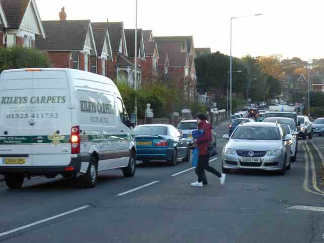 Walking to school sometimes isn't easy. Congestion around schools caused by widespread use of the car to transport children imposes problems on those who prefer or have to walk. Safety and air quality are compromised and an important opportunity for exercise denied.