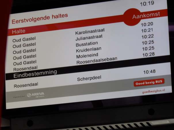 On-board bus information showing final destination and intermediate villages with 'real time' arrival times.